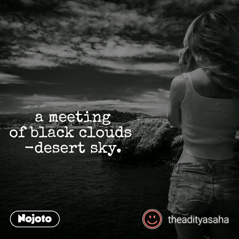 a meeting of black clouds  -desert sky.